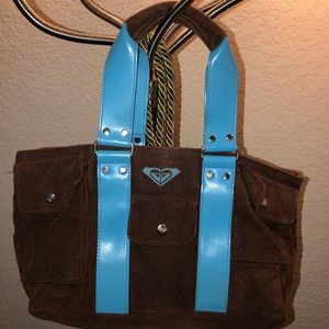 Roxy Corduroy bag with 3 front snap Pockets